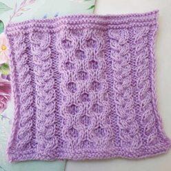 Классический узор из кос спицами для пуловера, схема узора