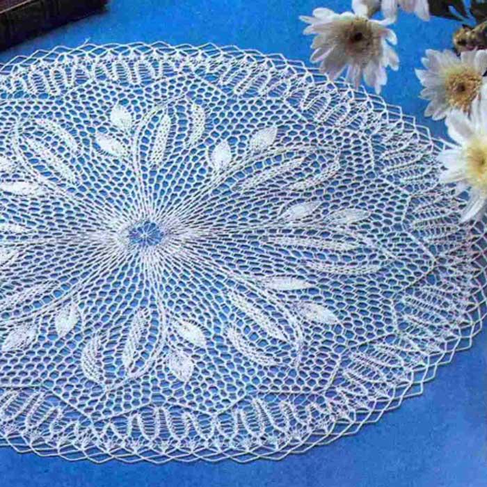 Круглая салфетка спицами «Березовые сережки»